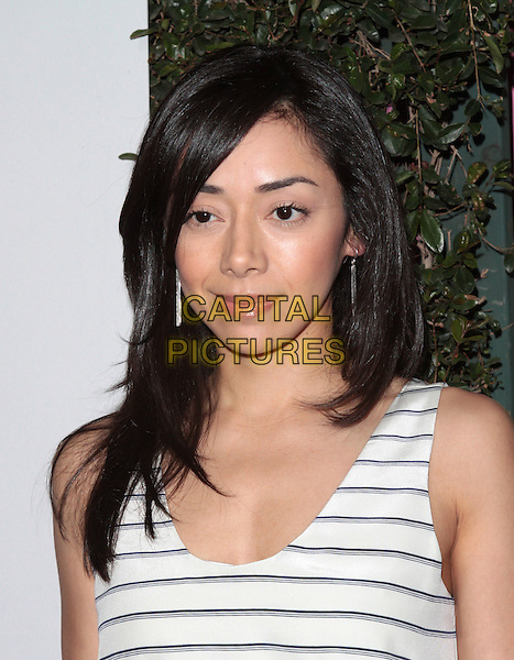 Aimee Garcia.The Grand Opening of Planet Dailies and Mixology 101 held at the Grove at the Farmers Market, Los Angeles, California, USA..5th April 2012.headshot portrait white sleeveless blue grey gray striped stripes .CAP/ADM/SP/JO.©James Orken/Starlitepics/AdMedia/Capital Pictures.