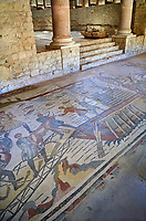 Wide picture of the Ambulatory corridor of the Great Hunt Roman mosaic and the entrance to the audience hall, room no 28, at the Villa Romana del Casale, first quarter of the 4th century AD. Sicily, Italy. A UNESCO World Heritage Site.<br /> <br /> The Great Hunt ambulatory is around 60 meters long (200 Roman feet) and connects the master's northern apartments with the triclinium in the south. The door in the centre of the the Great Hunt ambulatory leads to audience hall. <br /> <br /> The Great Hunt Roman mosaic depicts African animals being hunted and put onto ships to be taken to the Colosseum.