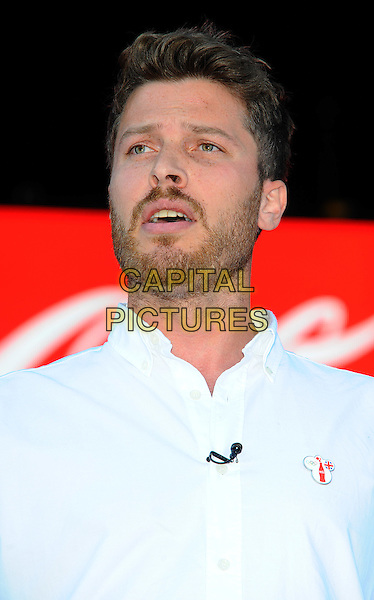 Rick Edwards.Launch of Coca-Cola's London 2012 Olympic Games global marketing campaign at Formanís Fish Island.London, England..29th, September 2011.headshot portrait white shirt beard facial hair .CAP/CJ.©Chris Joseph/Capital Pictures.