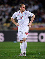 Wayne Rooney of England spits. USA tied England 1-1 in the 2010 FIFA World Cup at Royal Bafokeng Stadium in Rustenburg, South Africa on June 12, 2010.