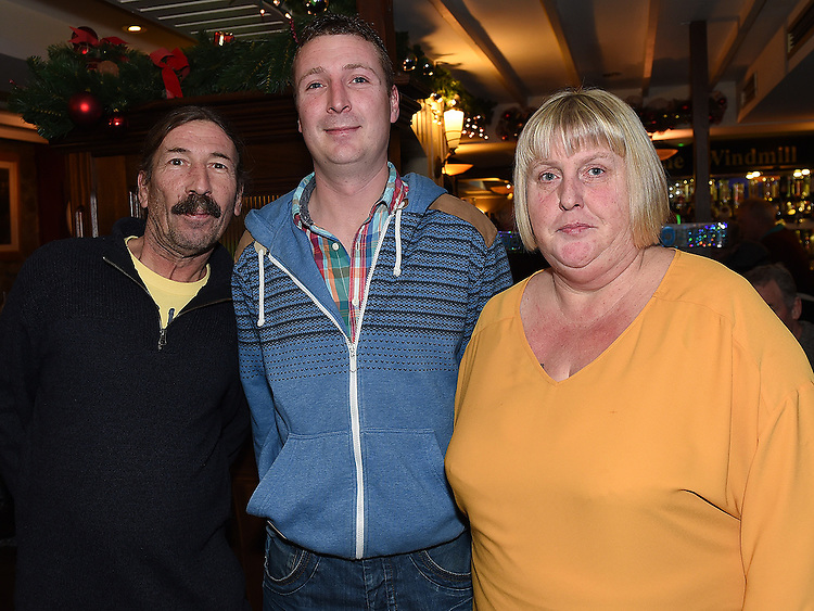 Gary O'Rourke celebrating his 30th birthday in The Windmill bar with parents Ciaran and Linda. Photo:Colin Bell/pressphotos.ie