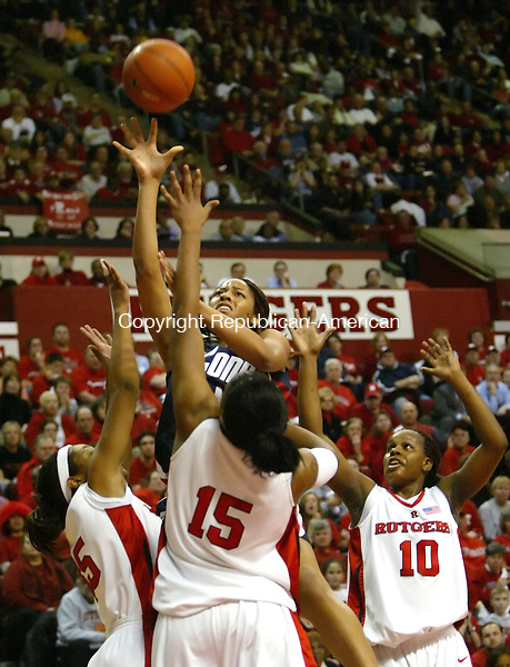 PISCATAWAY, NJ, 02/26/07- 022607BZ05- UConn's Brittany Hunter (44) goes up against   Rutgers's Judith Ray (35),  Kia Vaughn (15) and  Epiphanny Prince (10) <br /> during their game at Rutgers Monday night.<br /> Jamison C. Bazinet Republican-American
