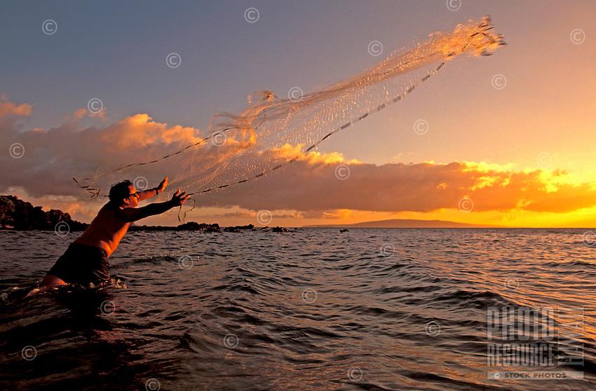 Throw net fisherman at sunset Kihei, Maui.