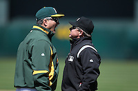 OAKLAND, CA - MAY 23:  First base umpire Greg Gibson #53 and manager Bob Geren #17 of the Oakland Athletics argue during the game against the San Francisco Giants at the Oakland-Alameda County Coliseum on May 23, 2010 in Oakland, California. Photo by Brad Mangin