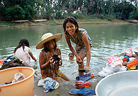 Fillipina girls doing their laundry in the Pansanjan River in the Philippines