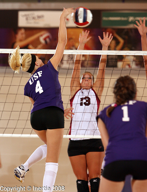 SIOUX FALLS, SD - SEPTEMBER 3:  Kali Angerman, #13 for Morningside tries to block the kill attempt of Kayla Rolsma, #4 for the University of Sioux Falls in the second game of their match Wednesday night at the Stewart Center. (Photo by Dave Eggen/Inertia).