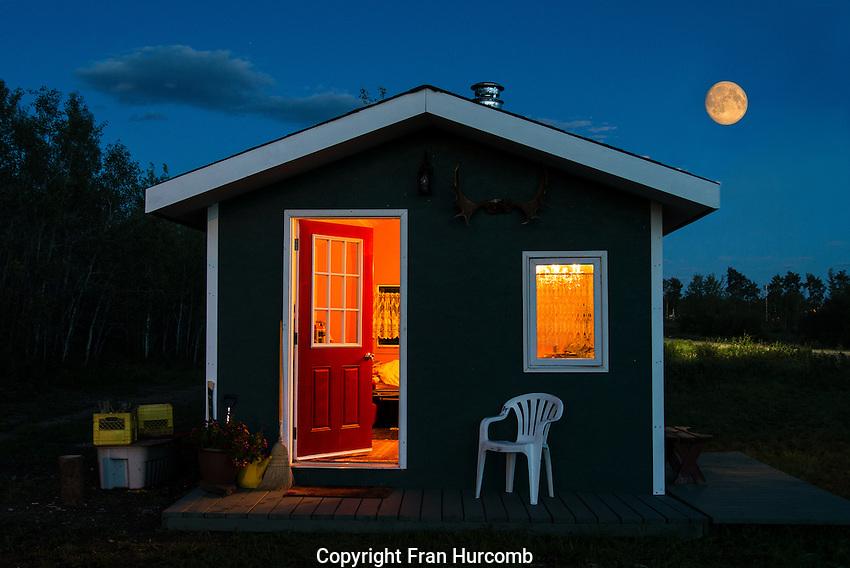 Full moon rising over cabin
