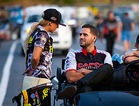 May 4, 2018; Commerce, GA, USA; NHRA top fuel driver Leah Pritchett (left) talks with husband Gary Pritchett during qualifying for the Southern Nationals at Atlanta Dragway. Mandatory Credit: Mark J. Rebilas-USA TODAY Sports