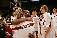 25 February 2006: Candice Wiggins and Brooke Smith hug Krista Rappahahn during Stanford's 78-47 win over the Washington State Cougars at Maples Pavilion in Stanford, CA.