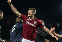 Zander Diamond of Northampton Town punches the air following the victory during the Sky Bet League 2 match between Oxford United and Northampton Town at the Kassam Stadium, Oxford, England on 16 February 2016. Photo by Andy Rowland.