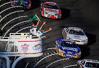 Mar 1, 2008; Las Vegas, NV, USA; The Nascar Nationwide Series flagman signals 10 laps to go during the Sams Town 300 at the Las Vegas Motor Speedway. Mandatory Credit: Mark J. Rebilas-US PRESSWIRE