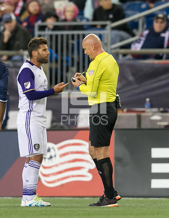 Foxborough, Massachusetts - April 30, 2016: In a Major League Soccer (MLS) match, the New England Revolution (blue/white) tied Orlando City SC (white), 2-2, at Gillette Stadium.<br /> Antonio Nocerino discuss yellow card to teammate.