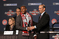 1st round 6th draft pick Rodney Wallace chosen y DC Utd shaking hands with MLS Commissioner Don Garber at the MLS Super Draft 2009.