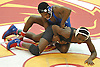 Jacori Teemer of Long Beach, top, battles Najee Hall of Uniondale at 126 pounds during the Nassau County Division 1 wrestling quarterfinals at Hofstra University on Saturday, Feb. 13, 2016. Teemer won by pin at 2:47.