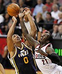 Utah Jazz forward Enes Kanter (0) and Portland Trail Blazers power forward J.J. Hickson (21) battle for rebound during first quarter of their NBA basketball game in Portland, Oregon, April 18, 2012.  REUTERS/Steve Dipaola (UNITED STATES)