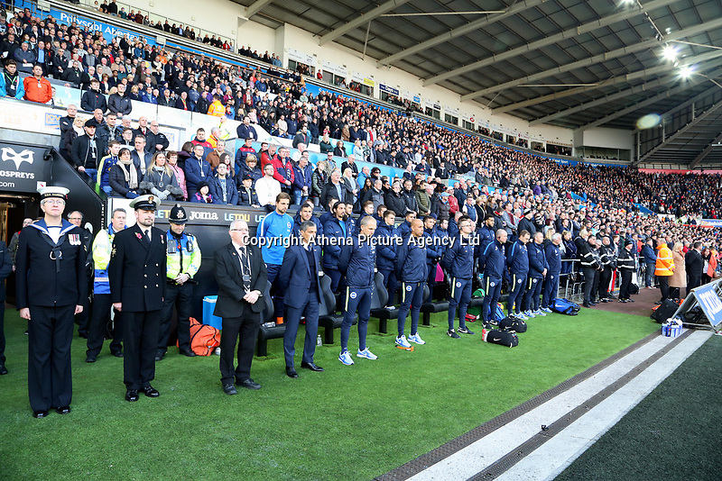 The Brighton bench observes a minute's silence during the Premier League match between Swansea City and Brighton and Hove Albion at The Liberty Stadium, Swansea, Wales, UK. Saturday 04 November 2017