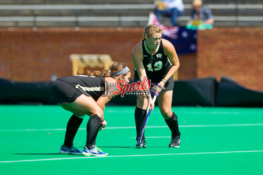 Jess McFadyen (13) and Kari Walkley (6) of the Wake Forest Demon Deacons get set for a penalty corner during first half action against the William & Mary Tribe at Kentner Stadium on September 15, 2013 in Winston-Salem, North Carolina.  The Demon Deacons defeated the Tribe 4-0.  (Brian Westerholt/Sports On Film)