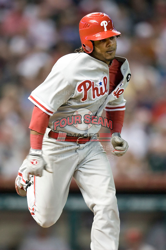 Philadelphia Phillies third baseman Michael Martinez #19 sprints to first base during the Major League Baseball game against the Houston Astros at Minute Maid Park in Houston, Texas on September 12, 2011. Houston defeated Philadelphia 5-1.  (Andrew Woolley/Four Seam Images)