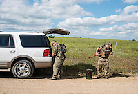 Patrick Bergmeier, and his brother, Ramond Bergmeier, prepare their guns during opening day of dove hunting season near Wamego, Kansas, Sunday, September 1, 2013. Opening day is known for being a festive day of hunting with family and friends. <br /> <br /> Photo by Matt Nager