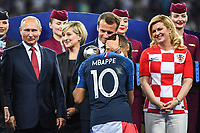 Russia's President Vladimir Putin, France's President Emmanuel Macron, Kylian Mbappe of France and Croatia's President Kolinda Grabar Kitarovic during the World Cup Final match between France and Croatia at Luzhniki Stadium on July 15, 2018 in Moscow, Russia. (Photo by Anthony Dibon/Icon Sport)