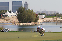 Tom Lewis (ENG) lines up his putt on the par3 13th green during Friday's Round 3 of the Commercial Bank Qatar Masters 2013 at Doha Golf Club, Doha, Qatar 25th January 2013 .Photo Eoin Clarke/www.golffile.ie
