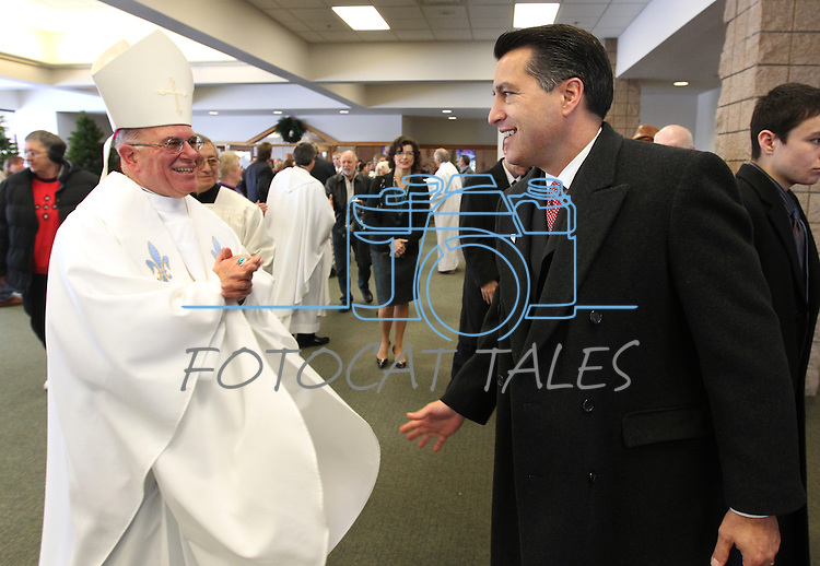 Bishop of Las Vegas Joseph A. Pepe congratulates Nevada Gov.-elect Brian Sandoval following Mass at St. Teresa of Avila Catholic Church in Carson City, Nev., on Monday, Jan. 3, 2011. The Sandoval family attended a special mass before the inauguration. <br /> Photo by Cathleen Allison
