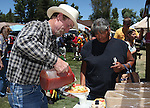 Sonny Abel and Linda Jones enjoy Indian tacos at the annual Stewart Father's Day Pow Wow at the historic Stewart Indian Facility in Carson City, Nev., on Sunday, June 16, 2013.<br /> Photo by Cathleen Allison
