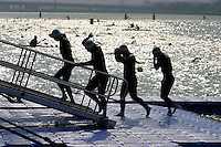 01 AUG 2004 - LONDON,UK - Competitors head for T1 at the 2004 London Triathlon. (PHOTO (C) NIGEL FARROW)