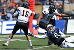 Nevada's Ian Seau (8) reaches for Southern Utah quarterback Aaron Cantu (15) during the first half of an NCAA college football game on Saturday, Aug. 30, 2014 in Reno, Nev. Southern Utah's Steve Clark (76) is at rear. (AP Photo/Cathleen Allison)