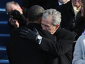 Washington, DC - January 20, 2009 -- United States President Barack Obama (L) is hugged by former President George W. Bush after Obama was sworn-in as the 44th President of the United States on the west steps of the Capitol on Tuesday, January 20, 2009.  .Credit: Pat Benic - Pool via CNP