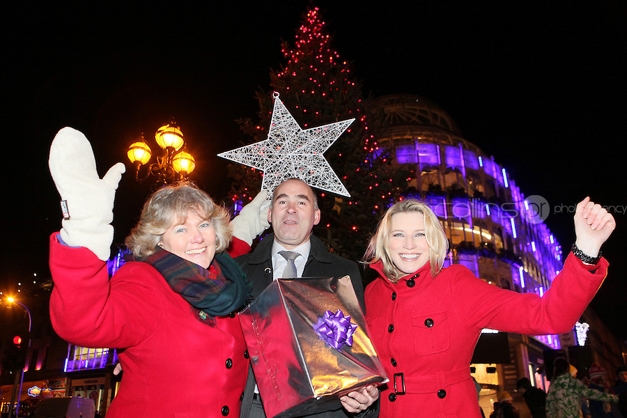 """NO REPRO FEE. 17/12/2010. Focus Ireland festive lights.  Joyce Loughnan, CEO Focus Ireland, Jim Dowdall, CEO Aviva Ireland and Pamela Flood switched on the lights on the Christmas Tree at Grafton St. this evening (Fri Dec 17th) for the Focus Ireland """"Sponsor a Star"""" campaign. EUR250,000 has been raised by businesses sponsoring a star on the landmark tree which is dedicated to people who are homeless. Picture James Horan/Collins Photos"""