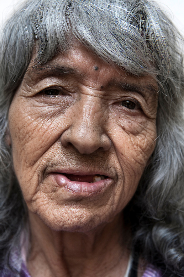 Portrait of Lupita, a resident of Casa Xochiquetzal, at the shelter in Mexico City on March 14, 2008. Casa Xochiquetzal is a shelter for elderly sex workers in Mexico City. It gives the women refuge, food, health services, a space to learn about their human rights and courses to help them rediscover their self-confidence and deal with traumatic aspects of their lives. Casa Xochiquetzal provides a space to age with dignity for a group of vulnerable women who are often invisible to society at large. It is the only such shelter existing in Latin America. Photo by Bénédicte Desrus