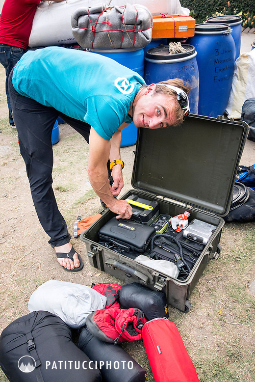 Ueli Steck packing solar panels and batteries with his climbing gear for he and David Göttler's 2016 Shishapangma South Face Expedition.