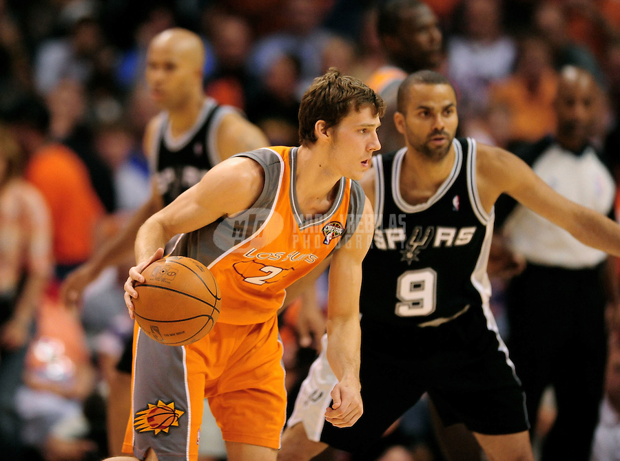 "May 5, 2010; Phoenix, AZ, USA; Phoenix Suns guard (2) Goran Dragic against the San Antonio Spurs in game two in the western conference semifinals of the 2010 NBA playoffs at the US Airways Center. The team is wearing ""Los Suns"" jerseys on Cinco de Mayo in response to an anti-immigration law recently passed in Arizona. The Suns defeated the Spurs 110-102. Mandatory Credit: Mark J. Rebilas-"