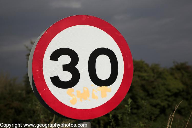 30 miles per hour circular road traffic sign, UK with graffiti