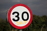 30 miles per hour circular road traffic sign, UK with graffiti