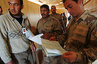 soldiers from 3d battalion, 1st brigade, 2nd Iraqi Army division wait for their turn while voting in the Iraqi National elections at their base in Camp Ramadi at a poling site under the administration of the Indipendent Electoral Commision of Iraq on Mon Dec 12 2005. At the end of the day about 2000 soldiers will vote at this site according to An Iraqi official.