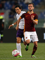 Calcio, Serie A: Roma vs Fiorentina. Roma, stadio Olimpico, 4 marzo 2016.<br /> Roma&rsquo;s Miralem Pjanic, right, is chased by Fiorentina&rsquo;s Tino Costa during the Italian Serie A football match between Roma and Fiorentina at Rome's Olympic stadium, 4 March 2016.<br /> UPDATE IMAGES PRESS/Riccardo De Luca