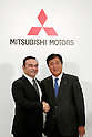 (L to R) Carlos Ghosn, Chairman and Chief Executive Officer of Nissan Motor Co., Ltd., shakes hands with Osamu Masuko, Mitsubishi Motors Corporation (MMC) President and Chief Executive Officer during a press conference on October 20, 2016, Tokyo, Japan. Ghosn announced that Nissan completed its acquisition of a 34% equity stake in MMC for 237 billion yen, becoming its single largest shareholder. (Photo by Rodrigo Reyes Marin/AFLO)