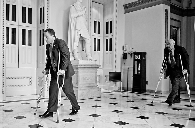 Rep. Steve Kagen, D-Wisc., left, followed closely by Reb. John Dingell, D-Mich., make their way through the Will Rogers Corridor on crutches following the House vote on healthcare for children on Jan. 14, 2009.