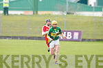 Kerry's John Griffin gets away from Derry's Alan Grant at Austin Stack park, Tralee on Sunday.