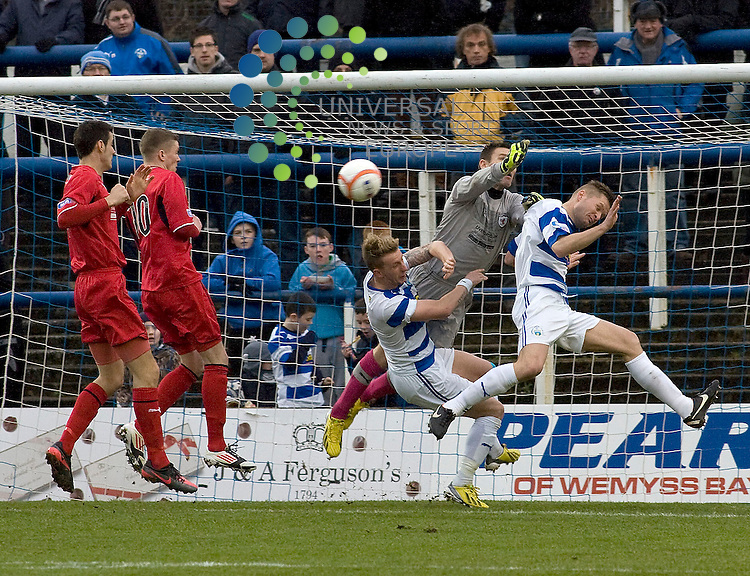 Morton forwards of Greenock Morton and David McGurn goalkeeper of Raith Rovers challenge for the ball during the Greenock Morton V Raith Rovers  Irn Bru Scottish First Division Match 2012-2013 at Cappielow Park, Greenock  .Picture: Campbell Skinner/Universal News And Sport (Scotland) 26th January 2013..