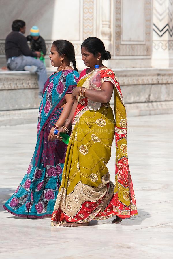 Agra, India.  Taj Mahal.  Two Indian Women Wearing Saris.