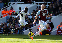 Pictured L-R: Nathan Dyer of Swansea against James Collins of West Ham. 01 February 2014<br />