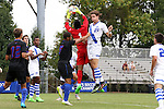 30 August 2015: DePaul's Quentin Low (1) catches the ball under pressure from Duke's Markus Fjortoft (NOR) (21). The Duke University Blue Devils hosted the DePaul University Blue Demons at Koskinen Stadium in Durham, NC in a 2015 NCAA Division I Men's Soccer match.