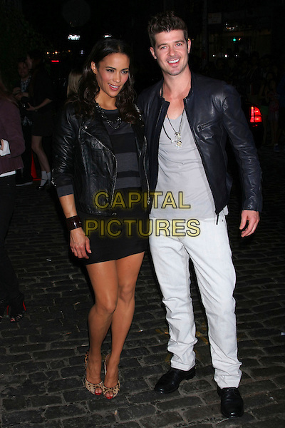 PAULA PATTON & ROBIN THICKE .at the Grand re-opening of Chanel Soho,  New York City, NY, USA, .September 9th, 2010..full length black dress leather jacket white grey gray trousers married couple husband wife leopard animal peep toe print shoes  striped .CAP/LNC/TOM.©LNC/Capital Pictures.
