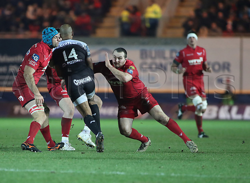 20th January 2018, Parc y Scarlets, Llanelli, Wales; European Rugby Champions Cup, Scarlets versus Toulonnaise; JP Pietersen of Toulon is stopped by Ken Owens and Tadhg Beirne of Scarlets