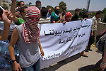"Palestinians demonstrate against the planned demolition of houses by the Israeli military in the village of An Nabi Salih near Ramallah on 11/06/2010. The Banner reads in English ""The threatens of demolishing our houses will not scare us of continuing our struggle"""