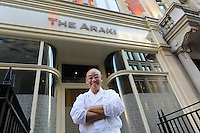 Sushi chef Mitsuhiro Araki standing outside his Mayfair restaurant, The Araki, London, UK, December 16, 2014. Following the success of his Three-Michelin-Star restaurant in Tokyo's Ginza, in 2014 Araki relocated to London.