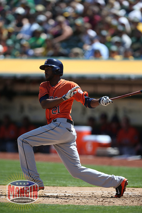 OAKLAND, CA - APRIL 19:  Dexter Fowler #21 of the Houston Astros bats against the Oakland Athletics during the game at O.co Coliseum on Saturday, April 19, 2014 in Oakland, California. Photo by Brad Mangin